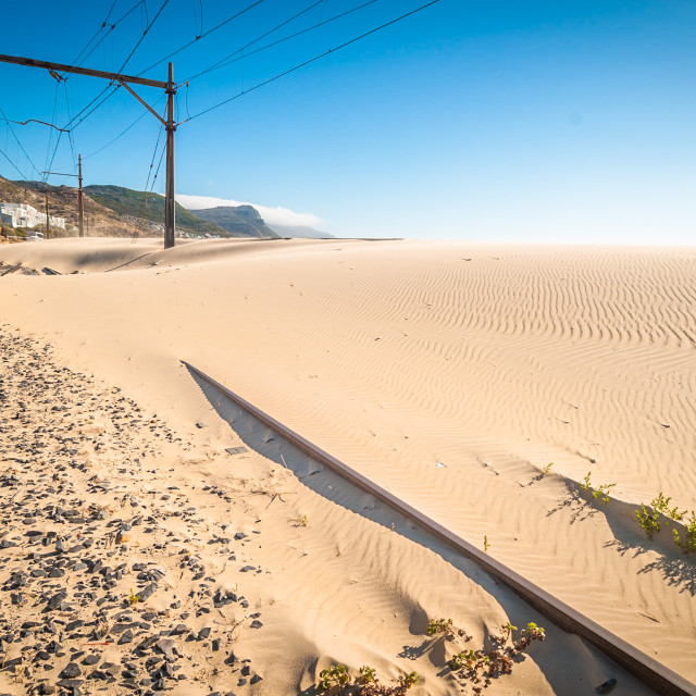 """""""Nature wins - sand covers a railway line."""" stock image"""