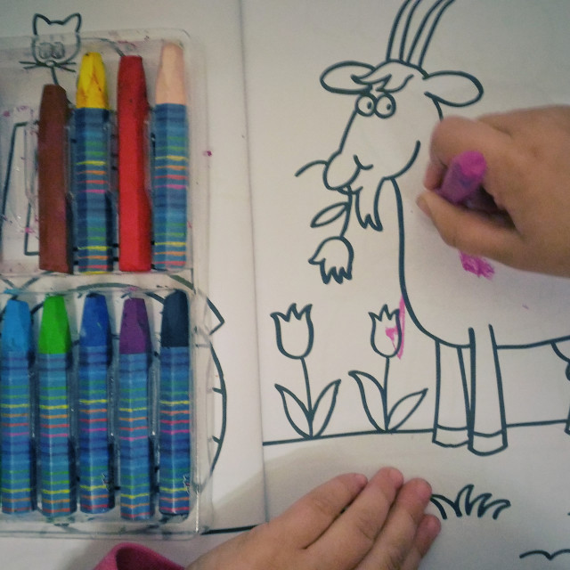 """""""Girl drawing with color pencil"""" stock image"""