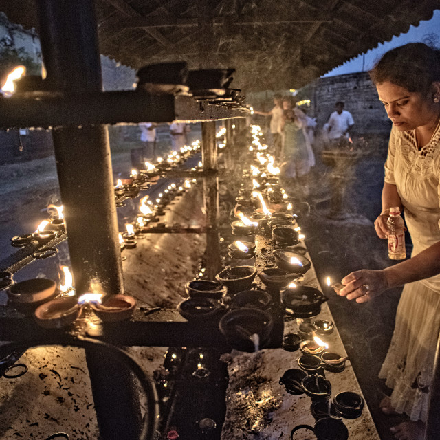 """Candle offerings at the Temple of the Tooth, Kandy, Sri Lanka"" stock image"