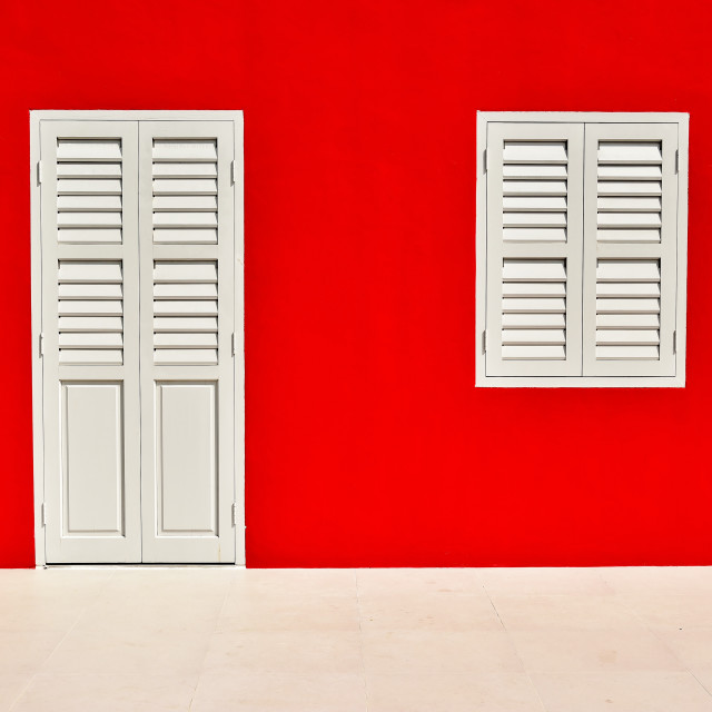 """White window and door on red wall"" stock image"