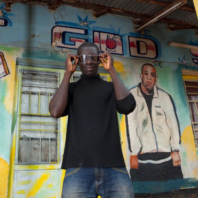 """Jean claude in front of fashion shop in kigali - rwanda"" stock image"