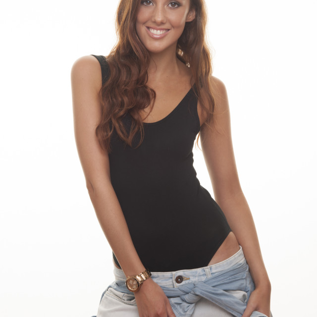 """woman smiling wearing low waisted baggy jeans & black body"" stock image"