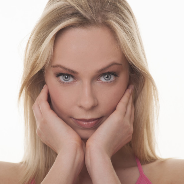 """blonde woman beauty hands on face"" stock image"