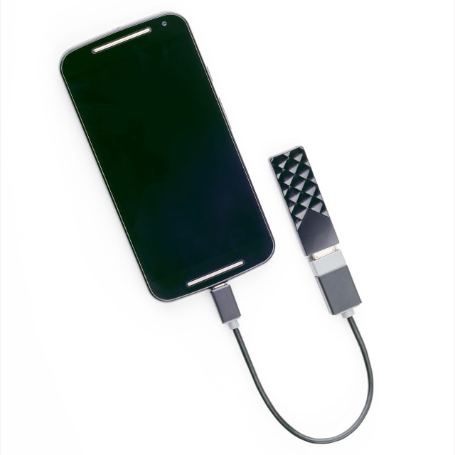 """""""Smartphone connected to a USB key with an OTG cable"""" stock image"""