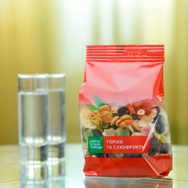 """""""Package of colorful dry fruits on a glass table"""" stock image"""