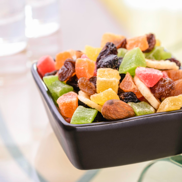 """""""Colorful dry fruits in a little black square bowl"""" stock image"""