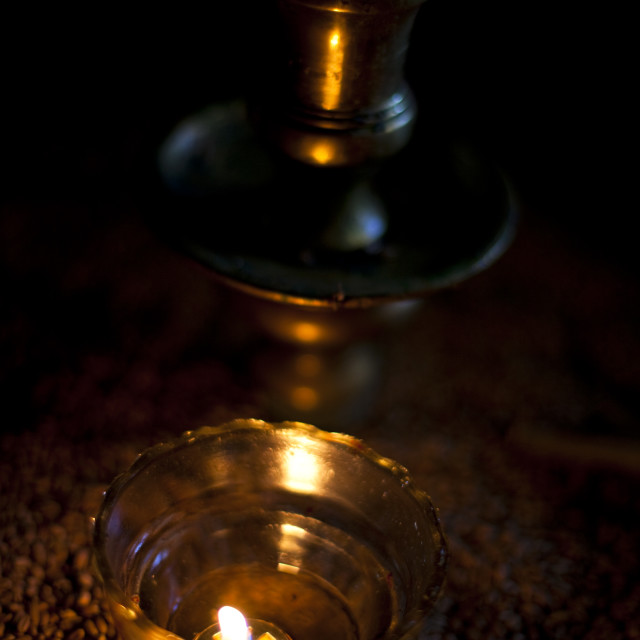 """""""Candle in the church of Aghios Stefanos, Drakona"""" stock image"""
