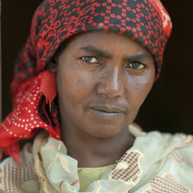 """""""Portrait Of A Serious Looking Woman Wearing A Red Hijab, Hargeisa, Somaliland"""" stock image"""