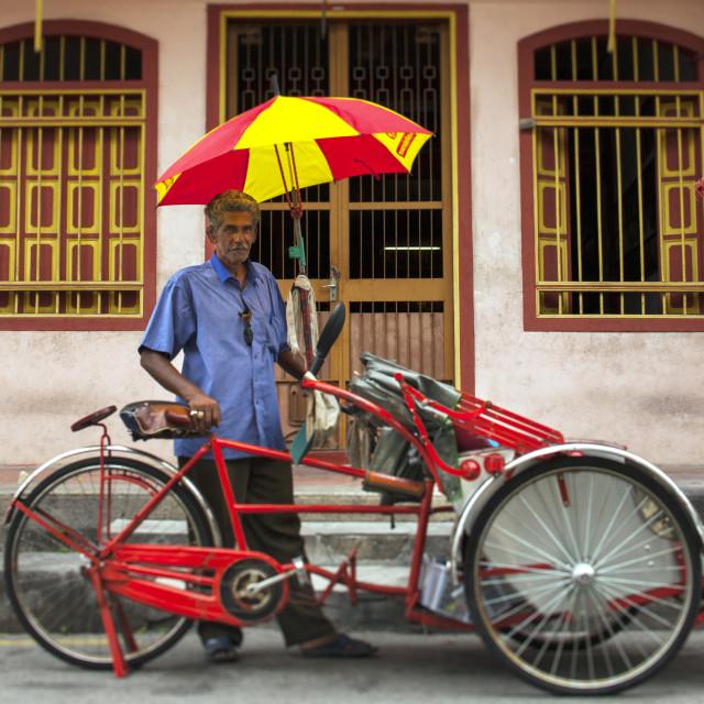 """Man With His Trishaw, George Town, Penang, Malaysia"" stock image"