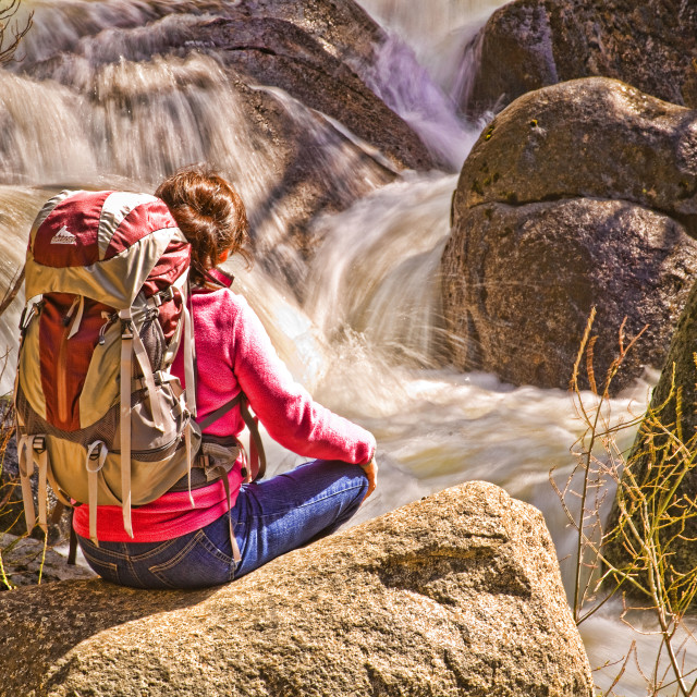 """Woman Backpacker Views Tumbling Waterfall"" stock image"