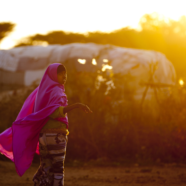 """""""A Woman Wearing A Pink Hijab Floating In The Wing At Sunset, Baligubadle,..."""" stock image"""