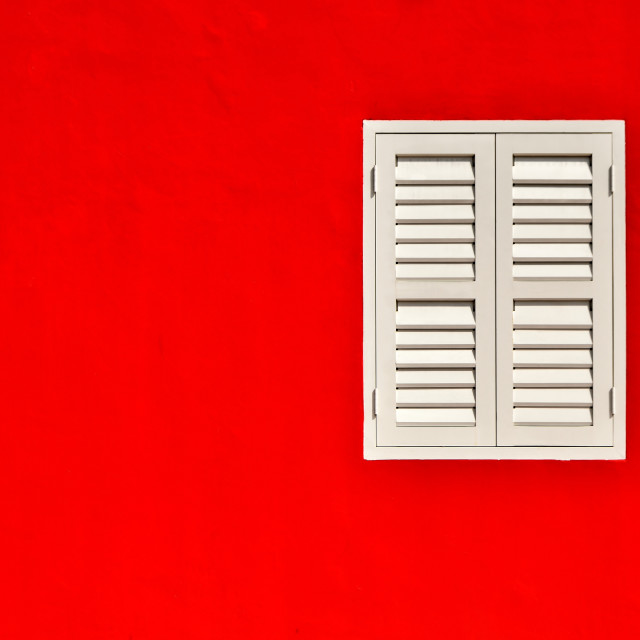 """White window on red wall"" stock image"