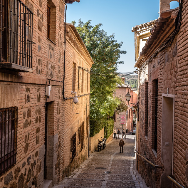 """Narrow street in the old jewish quarter of Toledo"" stock image"
