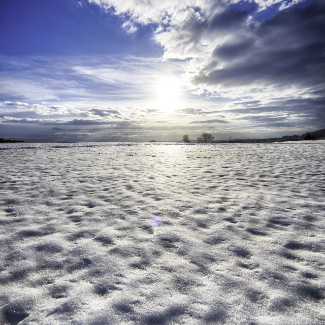 """Sun reflections on Snow"" stock image"