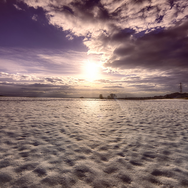 """Sunset over Snow field"" stock image"