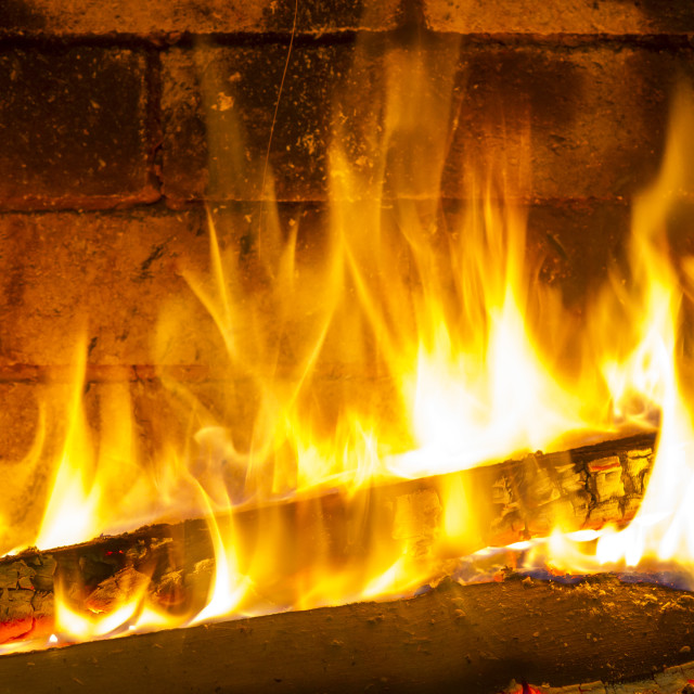 """Burning and glowing pieces of wood in Fireplace"" stock image"