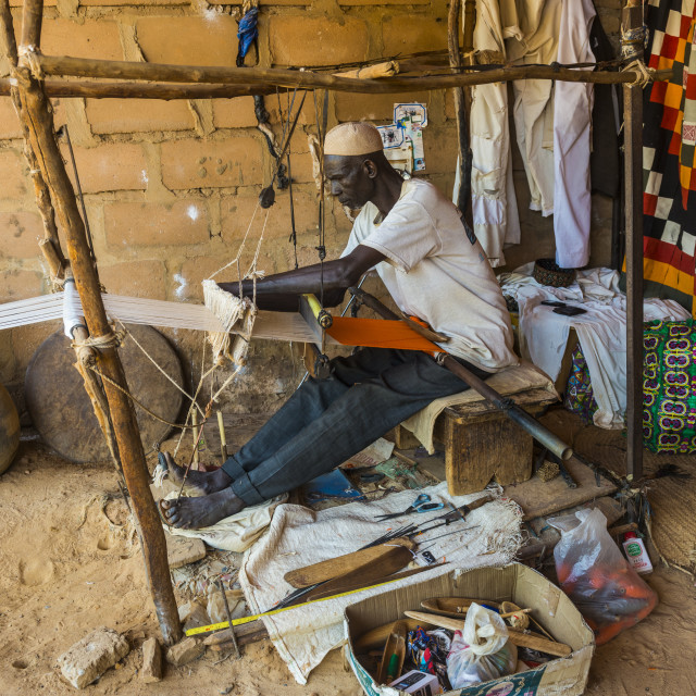 """""""Man waiving on a traditional loom in the National museum, Niamey, Niger"""" stock image"""