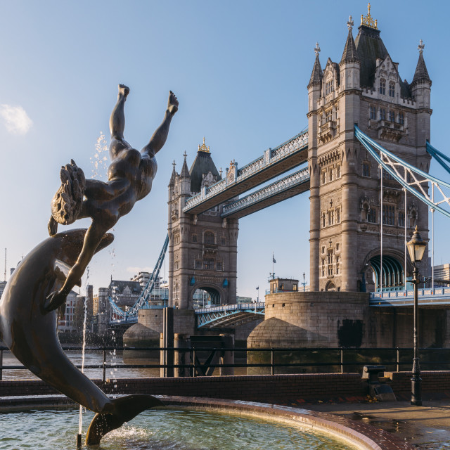 """""""Juxtaposition of David Wynne's Girl With A Dolphin Statue near Tower Bridge..."""" stock image"""