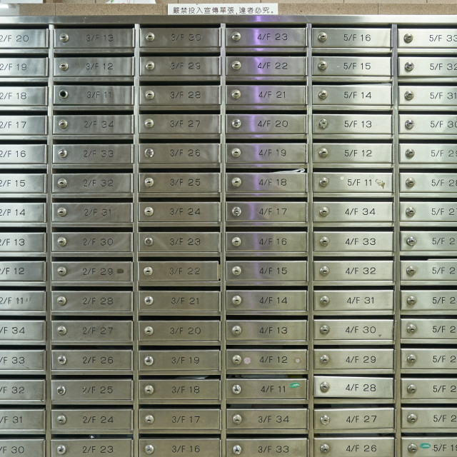 """Post boxes in the foyer of an apartment building, Hong Kong"" stock image"