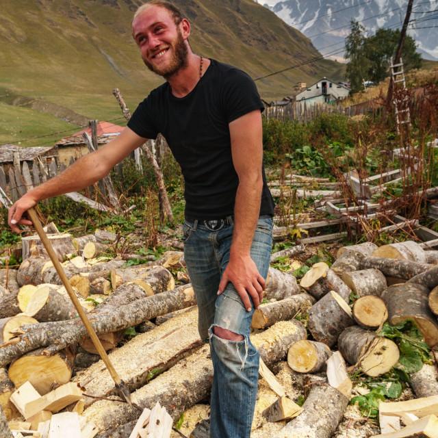 """""""Woodcutter against Mount Shkhara (Georgia's highest peak), Upper Svaneti..."""" stock image"""
