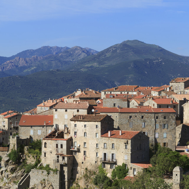 """""""Sartene, panoramic view of town with mountains behind"""" stock image"""