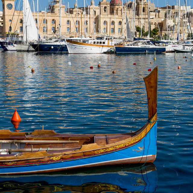 """""""Traditional boat moored in Grand Harbour marina at Birgu. Valletta is..."""" stock image"""
