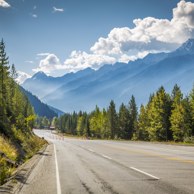 """Scenic view of the mountains aligning the Trans Canada Highway in Glacier..."" stock image"