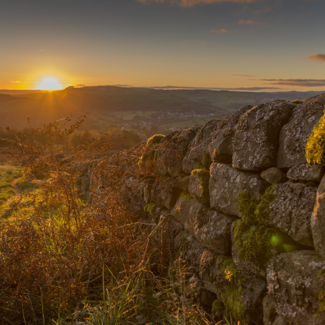 """View of sunset from dry stone wall on Baslow Edge, Baslow, Peak District..."" stock image"