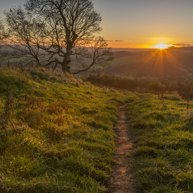 """View of sunset from path on Baslow Edge, Baslow, Peak District National Park,..."" stock image"