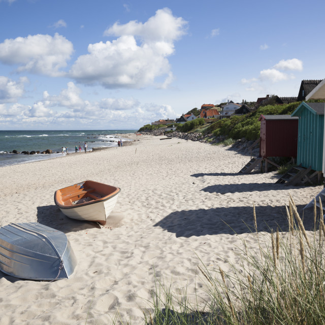 """Boats and beach huts on white sand beach with town behind, Tisvilde, Kattegat..."" stock image"