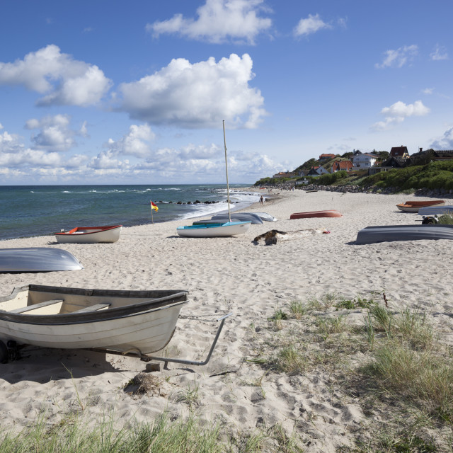 """Boats on white sand beach and town behind, Tisvilde, Kattegat Coast, Zealand,..."" stock image"
