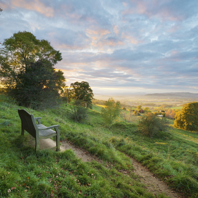 """Cotswold Way path and bench with views to the Malvern Hills at sunset, Ford,..."" stock image"