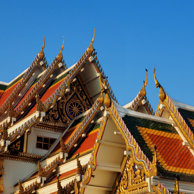 """""""Buddhist temple`s roofs soar into blue sky"""" stock image"""