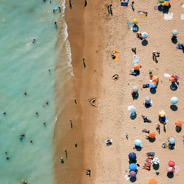 """Aerial Drone View Of People On Beach In Portugal"" stock image"