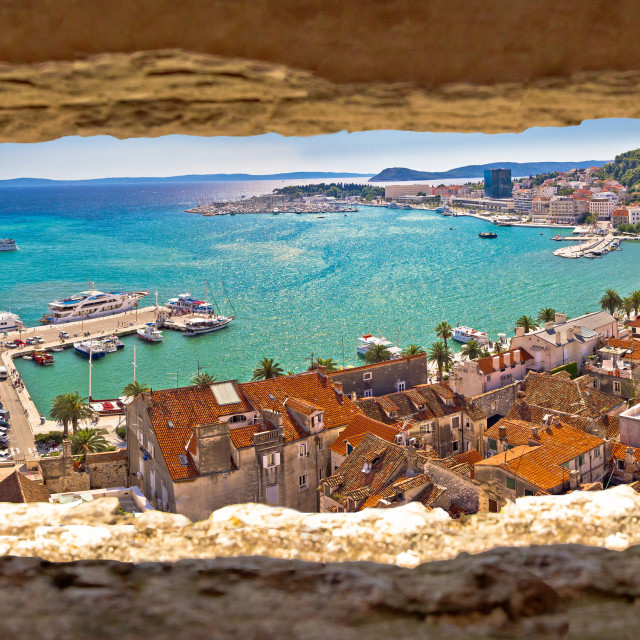 """Split waterfront aerial panoramic view through stone window"" stock image"