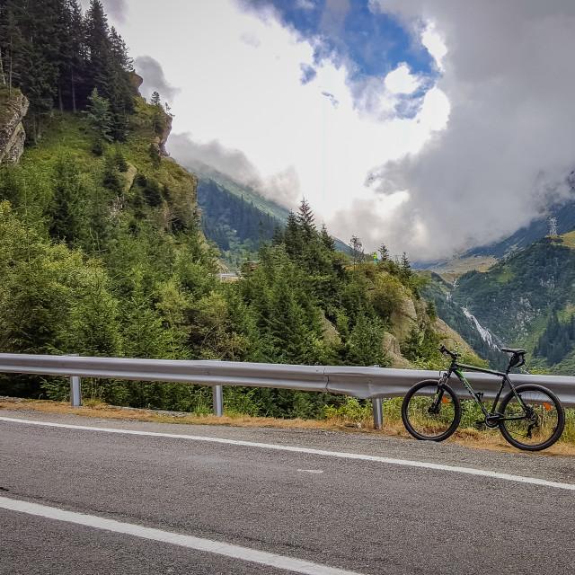 """""""Cycling in the heart of the Fagaras Mountains, Transfagarasan"""" stock image"""