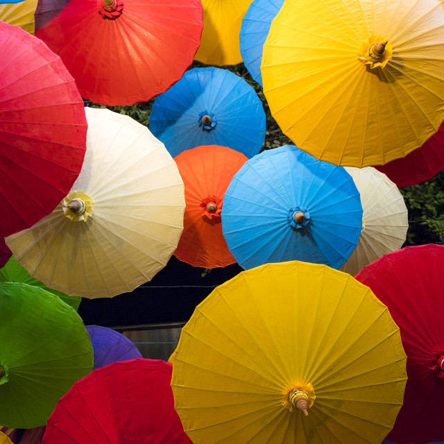 """Umbrellas at the night market"" stock image"