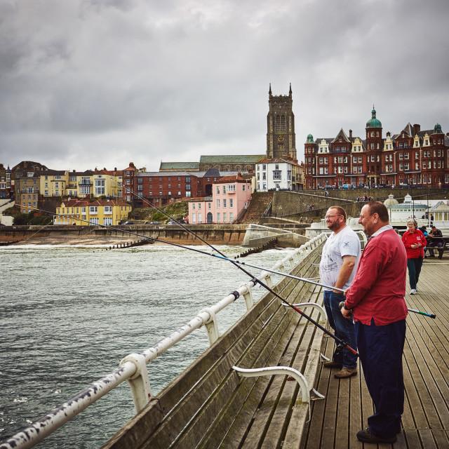 """Fishing on Cromer Pier"" stock image"