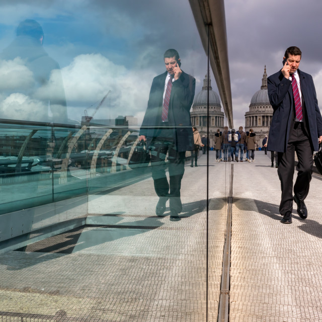 """Businessman Reflection, Millennium Bridge, London"" stock image"