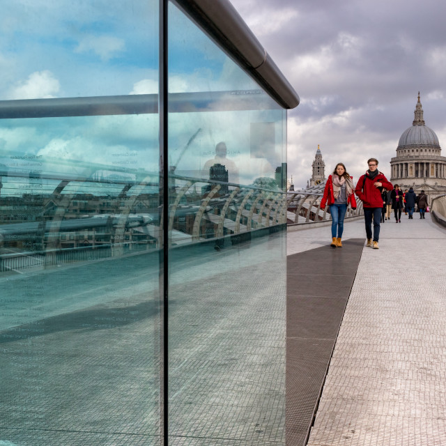 """Tourists in Red, Millenium Bridge, London"" stock image"