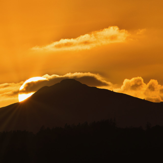 """The sun sets behind Bennachie"" stock image"