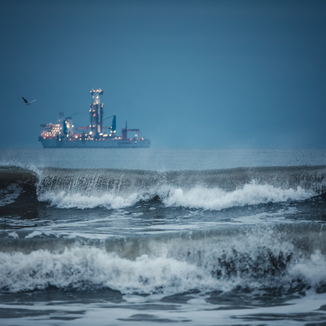 """""""International Container Cargo ship in the sea water after sunset"""" stock image"""