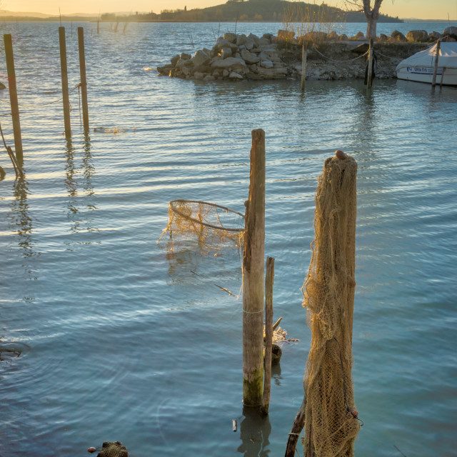 """Jetty posts and fishing nets"" stock image"
