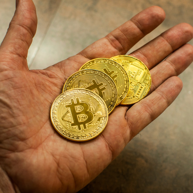 """Hand holding Bitcoin 2"" stock image"
