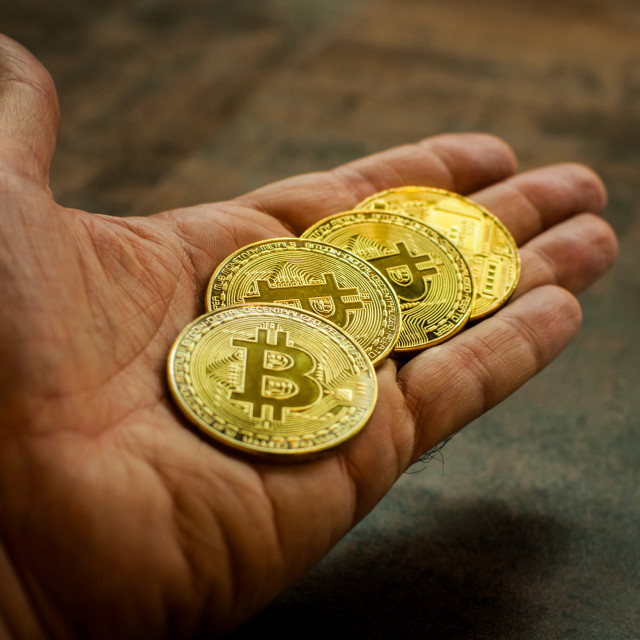 """Hand holding Bitcoin 3"" stock image"