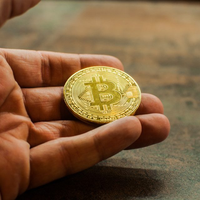 """Hand holding Bitcoin 1"" stock image"