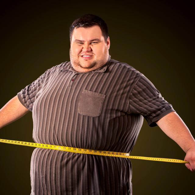 """Man belly fat with tape measure weight loss around body ."" stock image"