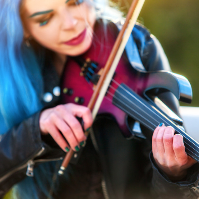 """Woman perform music on violin park outdoor. Girl performing jazz."" stock image"