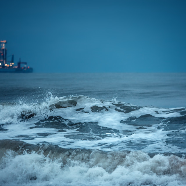 """""""Surfer catches huge waves in the deep sea water after sunset. Ca"""" stock image"""