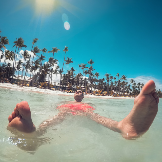 """Man enjoying turquoise water of Caribbean sea and Punta Cana bea"" stock image"